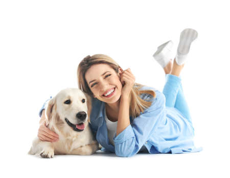 Portrait of happy woman with her dog on white background Stock Photo