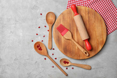 Wooden kitchen utensils on table, top view