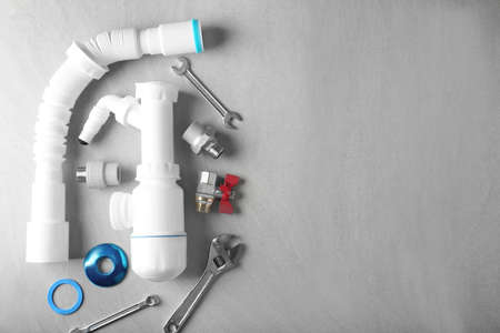 Plumbers items on light background Stock Photo