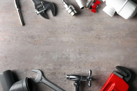 Plumbers items on textured background Stock Photo