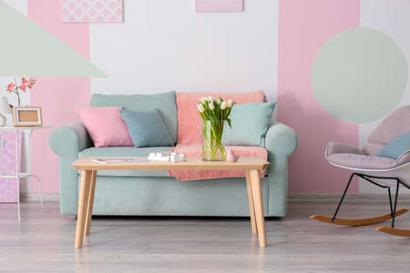 Elegant living room interior with table and comfortable sofa Stock Photo