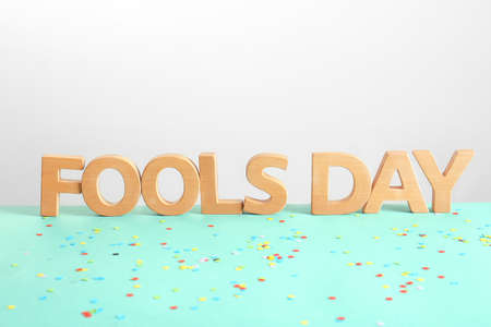 Phrase Fools day and confetti on table. 1st April celebration Stock Photo
