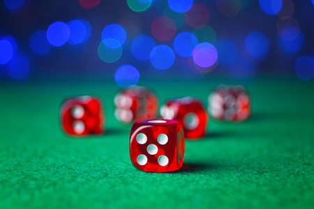 Dices on green table in casino