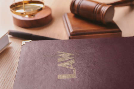 Law book and gavel on table. Legal immigration