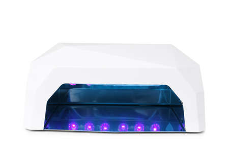 Ultraviolet lamp for manicure on white background