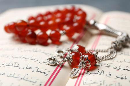 Holy book of Muslims and prayer beads, closeup Stock Photo
