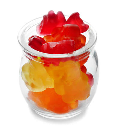Glass jar with colorful jelly candies on white background