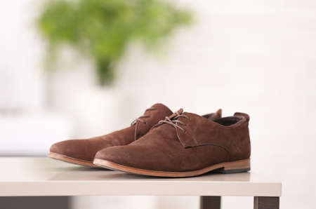 Pair of elegant male shoes against blurred background Stock Photo