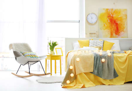 Comfortable soft bed with pillows in modern room