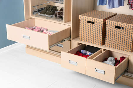 Drawers of wardrobe closet with clothes 스톡 콘텐츠