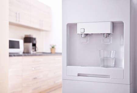 Modern water cooler in kitchen