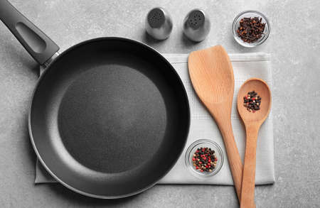 Cooking utensils and spices on gray background, top view Stock Photo