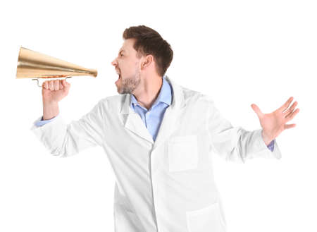 Male doctor with megaphone on white background Stock Photo