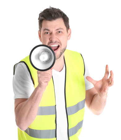 Worker with megaphone on white background Stock Photo