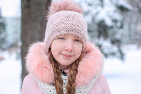 Cute girl in snowy park on winter vacation