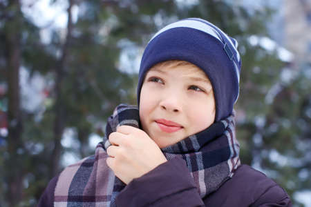 Cute boy in park on winter vacation