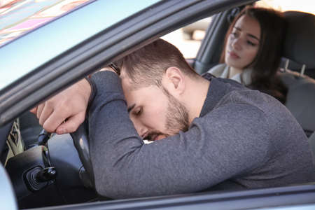 Young couple in car during traffic jam Stock Photo