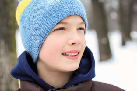 Cute boy on frosty day outdoors. Winter vacation