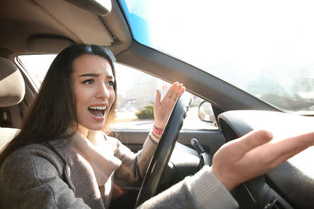 Young woman in car during traffic jam Stock Photo