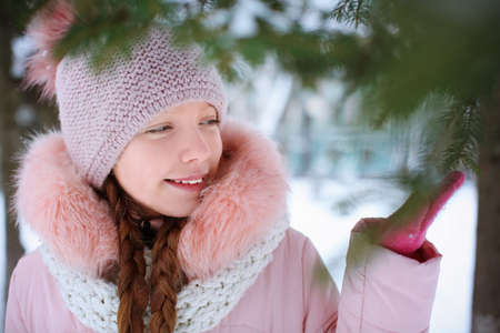 Cute girl on frosty day outdoors. Winter vacation Stock Photo