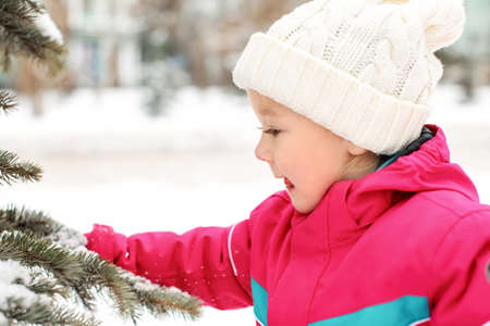 Cute little girl on frosty day outdoors. Winter vacation Stock Photo