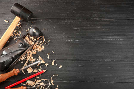 Set of carpenter's tools on wooden background