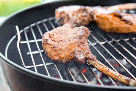 Cooking of appetizing juicy spare ribs outdoors Stock Photo