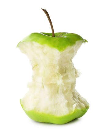 Half-eaten green apple isolated on white