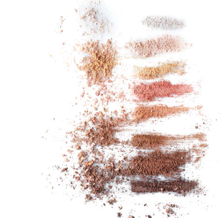 Crushed eye shadows on white background. Professional makeup products