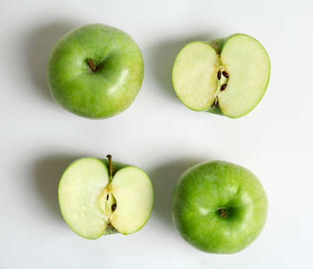 Fresh green apples on white background, flat lay