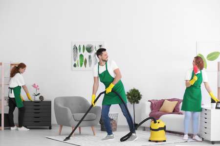 Team of young cleaning service professionals at work indoors Stock Photo