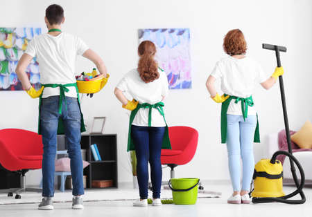 Team of young cleaning service professionals indoors