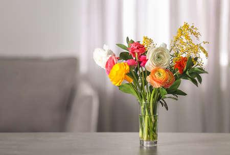 Vase with beautiful ranunculus flowers indoors
