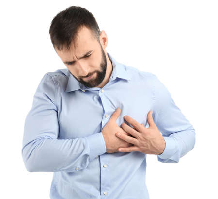 Young man suffering from chest pain on white background Banco de Imagens
