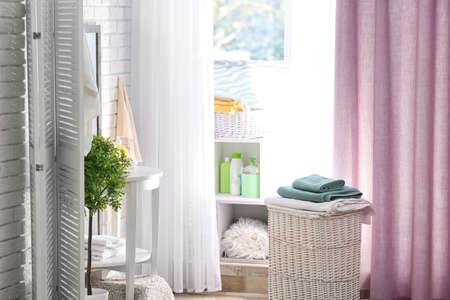 Modern bathroom interior with laundry basket Stock Photo