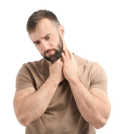 Young man suffering from sore throat on white background