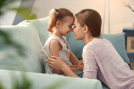 Portrait of happy mother and daughter at home 스톡 콘텐츠
