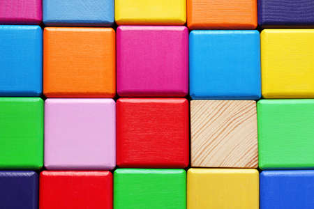 Wooden cubes and one different, closeup Foto de archivo