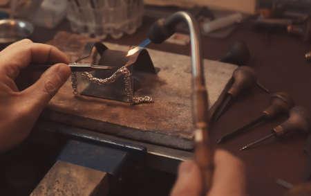 Jeweler working with blow torch, closeup Standard-Bild