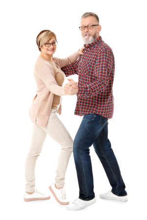 Happy senior couple dancing on white background 스톡 콘텐츠