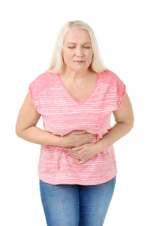 Woman suffering from abdominal pain on white background