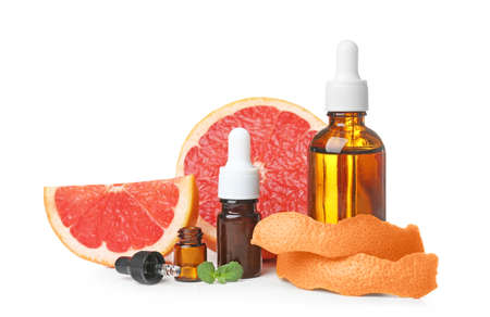 Composition with grapefruit essential oil on white background Stock Photo