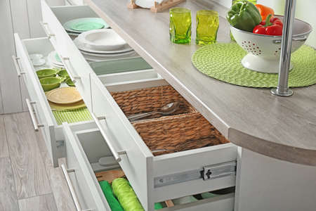Drawers with different kitchenware 스톡 콘텐츠