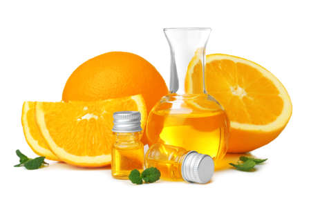 Composition with orange essential oil on white background