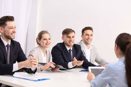 Human resources commission conducting job interview with applicant, indoors