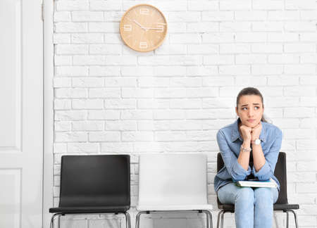 Young woman waiting for job interview, indoors Stock Photo