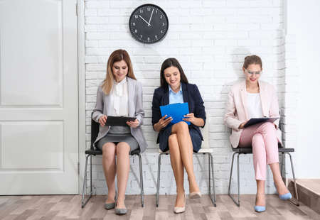 Young women waiting for job interview, indoors