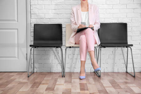 Young woman waiting for job interview, indoors