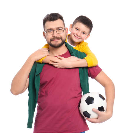 Little boy and his dad with soccer ball on white background Foto de archivo