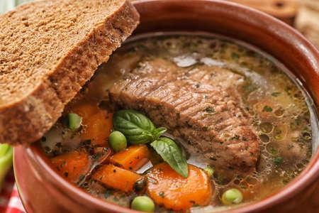 Crock pot with stewed meat, closeup Stock Photo